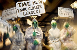 Activists from Avaaz.org dressed as aliens roam the halls of the Bella Center during the UN Climate Change Conference 2009 in Copenhagen